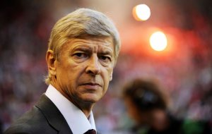 Arsenal coach Arsene Wenger looks on prior to their Champions League third round first leg soccer match against FC Twente at the Gelredome stadium in Arnhem, eastern Netherlands, Wednesday, Aug. 13, 2008. (AP Photo/Ermindo Armino)